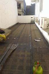 pemasangan membran bakar teras dak beton